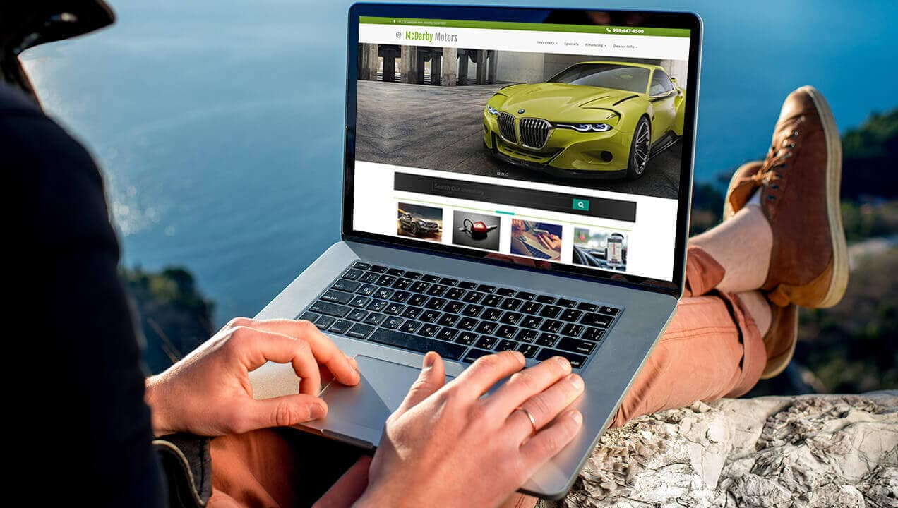 McDarby Motors website on laptop